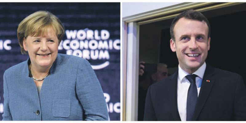 Forum de Davos: Merkel et Macron en vedette